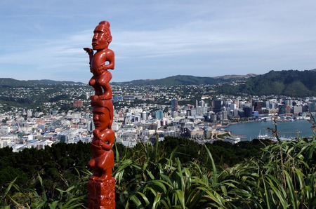 new zealand: An ancient Maori sculpture of man and a woman mad out of wood on top of Mt victoria in Wellington, New Zealand. Stock Photo