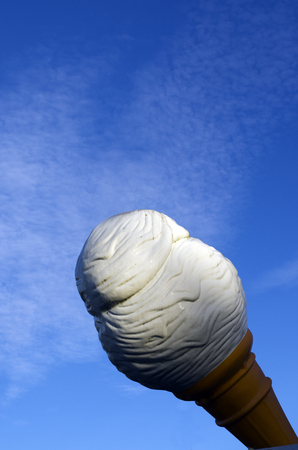 heathy diet: Giant vanilla ice cream cone isolated against blue sky with copy space. Stock Photo