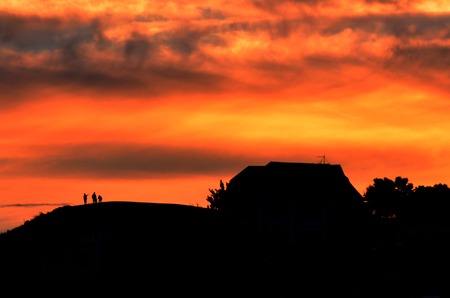 dramatic: Dramatic sunset over family home.