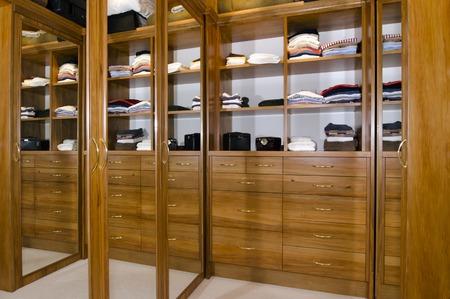 walk in closet: A walk in wardrobe inside a bedroom home. Stock Photo