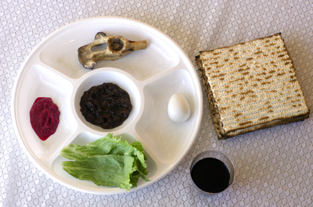 pesach: Passover Seder Plate on the table during the Jewish holiday on Passover - Pesach eve.