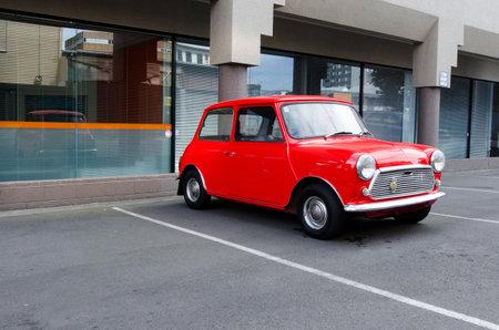Classic mini model in a car parking lot. Editorial