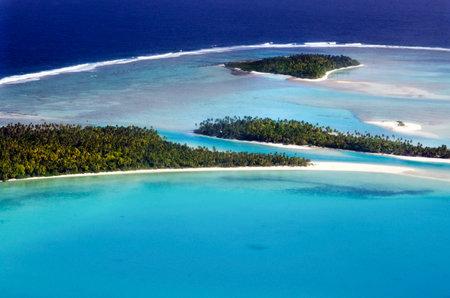 AITUTAKI - SEP 16:Aerial view of One foot island, Tekopua island and Motukitiu Island on Sep 16 2013.Polynesians first settled Aitutaki around AD 900. Editorial