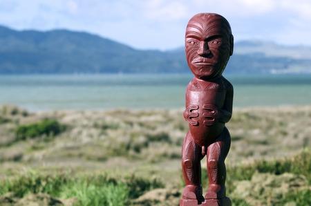 aotearoa: Wood carving of Maori figurine.