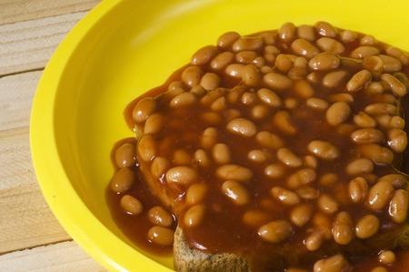 beans on toast: Baked beans on piece of toast. Stock Photo
