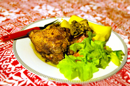 fijian: Traditional Fijian food , spicy chicken and root vegetables in a plate on the table.