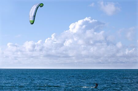 watersport:  combination of the wake boarding, windsurfing, surfing, paragliding, and gymnastics into one extreme sport
