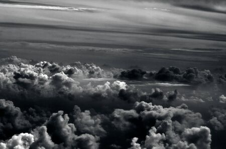 heave: Landscape of clouds as seen from airplane window during flight in the air. (BW)