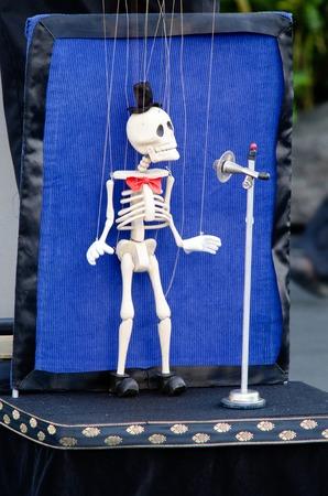 puppeteer: Skeleton puppeteer singing in the street. Stock Photo