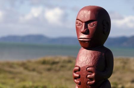 wood figurine: Wood carving of Maori figurine.