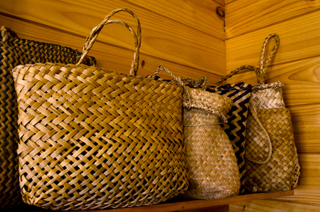 gift bags: Traditional Maori flax bags on a shelf.