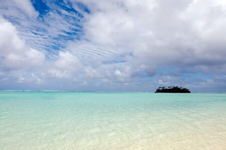 islet: Seascape of small coral islet at Muri Lagoon in Rarotonga Cook Islands.
