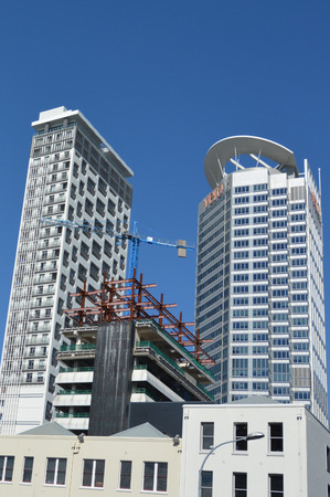 homebuyer: AUCKLAND,  NZL - AUG 10 2015:New apartment buildings in Auckland downtown.House prices are booming around New Zealand with the average price of an Auckland city home rocketing to $735,692