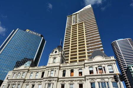 commercially: AUCKLAND - AUG 10 2015:Auckland old Customhouse under modern building. Since the 19th century European settlement Auckland become the fastest-growing and commercially dominating city of New Zealand Editorial