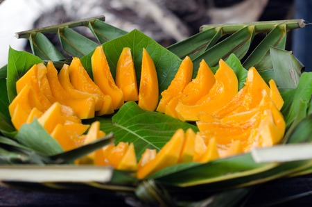 grope: Slices of Papaya fruit on a leaf plat in Pacific Island.