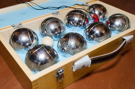 Petanque balls in a wooden box.