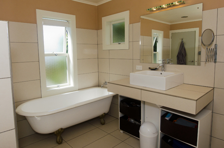 master bath: Luxury bathroom with mirrors, sink and classic bath.