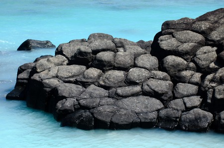 rarotonga: Black Rock, or Touro, legendary departure place of the deceased souls of the Cook Islanders, Polynesians ancestors. Today its a famous landmark and popular swimming place in Rarotonga, Cook Islands. Stock Photo