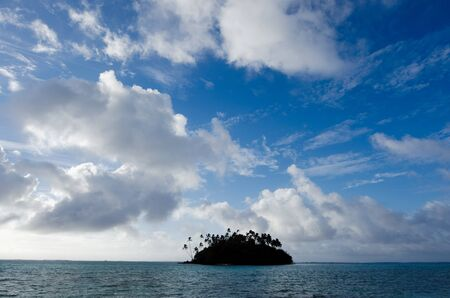 islet: Seascape of a small coral islet at Muri Lagoon in Rarotonga Cook Islands during sunrise.