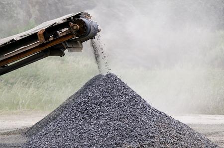 gravel: Gravel machine pouring gravel stones into a pile. Stock Photo