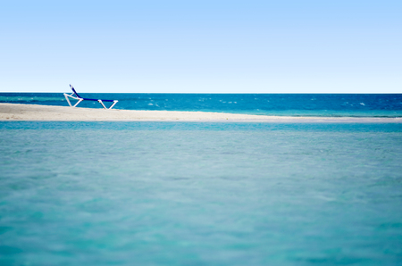 sandbank: Empty beach chairs on sandbank in Arutanga island in Aitutaki Lagoon Cook Islands.