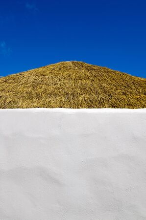 blu sky: Roof of a small pacific island hut against blu sky  in Rarotonga Cook Islands.