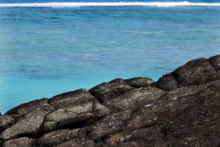 legendary: Black Rock, or Touro, legendary departure place of the deceased souls of the Cook Islanders, Polynesians ancestors.  Stock Photo