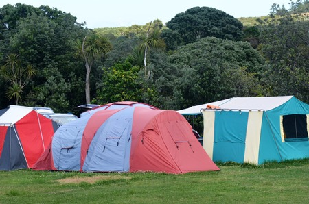 campsite: Colorful tents in campsite during summer vacation. Stock Photo
