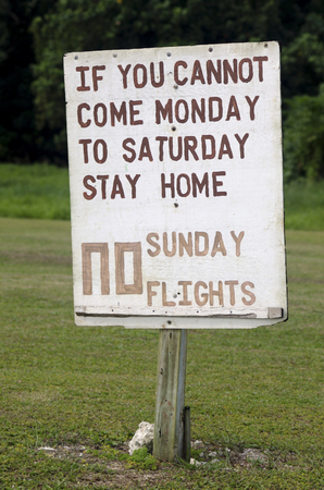 protesting: No Sunday Flights protesting sign in Aitutaki Lagoon Cook Islands Stock Photo