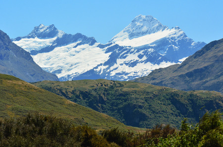 aspiring: Mount Aspiring (R) in the Otago region of the South Island of New Zealand. Stock Photo
