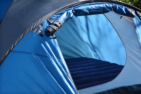 Empty tent set up outdoor in the nature. concept photo of travel outdoor. Stock fotó