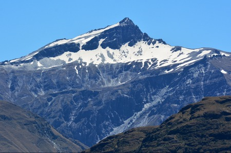 aspiring: Black peak mountain iMount Aspiring National Park in the Otago region of the South Island of New Zealand.