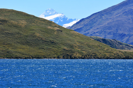 Mount Aspiring raise above Wanaka lake in the Otago region of the South Island of New Zealand. Stock Photo