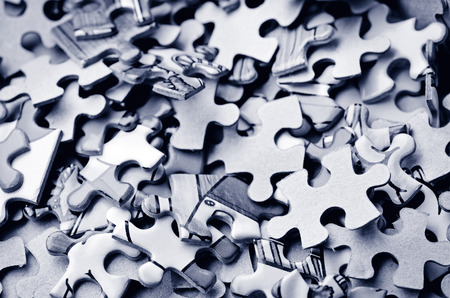 randomness: Mix of colorful puzzle  piece. Concept of non-order and chaos Stock Photo