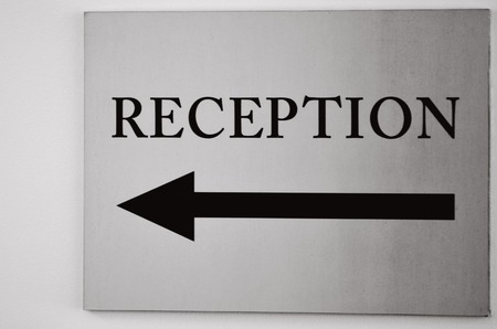 bw: Reception sign with direction arrow. (BW) Stock Photo