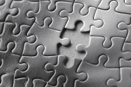 final piece of puzzle: Missing jigsaw puzzle piece. Business concept for completing the final puzzle piece (BW)