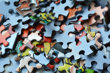 chaos: Mix of colorful puzzle  piece. Concept of non-order and chaos Stock Photo