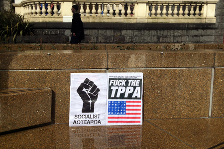 new economy: AUCKLAND - AUG 15 2015:Protester sign against TPP trade agreement in Auckland.12 nations including New Zealand have been negotiating the TTP trade deal, which would cover 40% of the world economy.