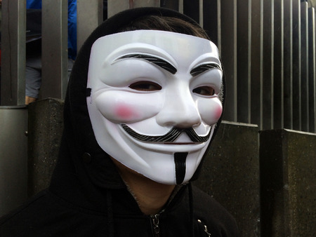 guy fawkes mask: AUCKLAND,  NZL - AUG 01 2015:Individual appearing in public as Anonymous, wearing Guy Fawkes mask.In 2012, Time called Anonymous one of the 100 most influential people in the world.