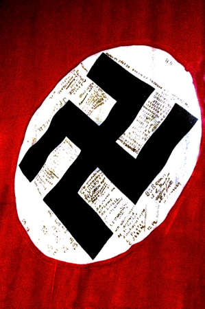 nazi flag: AUCKLAND -AUG 16 2015:The swastika flag  of Nazi Germany in on display in Auckland Museum.The swastika was the flag of Nazi Germany and the Nazi Party between (1935–45)
