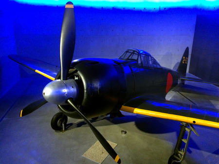 monoplane: AUCKLAND - AUG 16 2015:Mitsubishi A6M Zero in Auckland Museum.Its a long-range fighter aircraft,  operated by Imperial Japanese Navy (1940 to 1945) used in kamikaze operations during World War II.