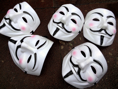 occupy movement: AUCKLAND - AUG 15 2015:Guy Fawkes masks on the ground during a public protest. In 2012, Time called Anonymous one of the 100 most influential people in the world. Editorial