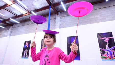 Little child ( girl age 05)  learn circus skills of plate spinning.