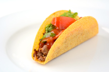 latin food: Mexican taco served on a white plate in Homemade Mexican restaurant in Mexico. Close-up food background and texture