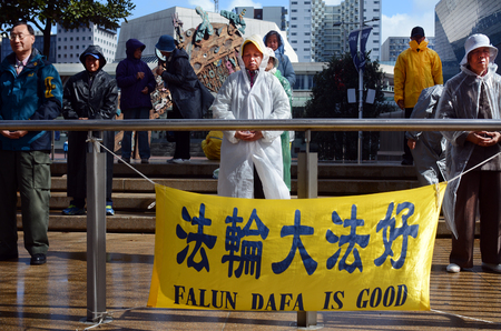 abuses: AUCKLAND - SEP 03 2015:Chines people practicing Falun Dafa in Aotea Square. Its a Chinese spiritual practice that combines meditation and exercises with moral philosophy of compassion and forbearance Editorial
