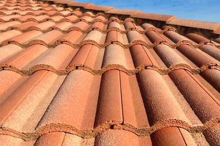 spanish style: Spanish style ceramic tile roof with blue sky. Background texture Stock Photo