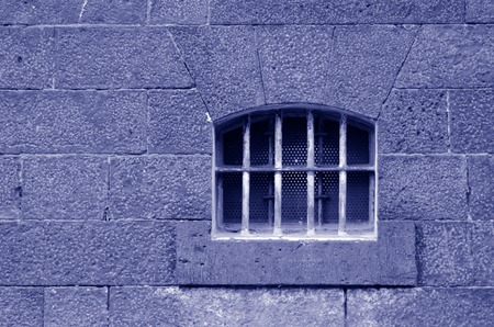 illegal act: Old prison cell window and wall. Concept photo of crime , prison, freedom, justice, punishment, captivity, hope.