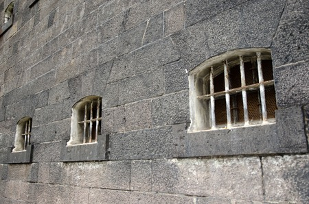 illegal act: Old prison cells windows and wall. Concept photo of crime , prison, freedom, justice, punishment, captivity, hope.