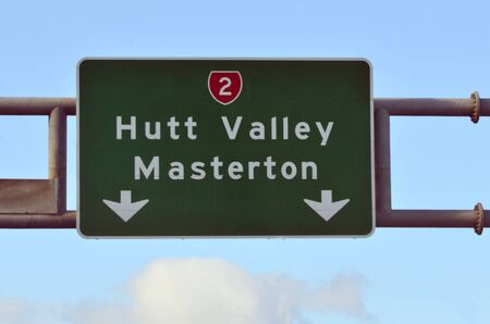 express lane: Road sign of Hutt Valley and Masterton on Hutt Expressway - State Highway 2 in Wellington New Zealand.