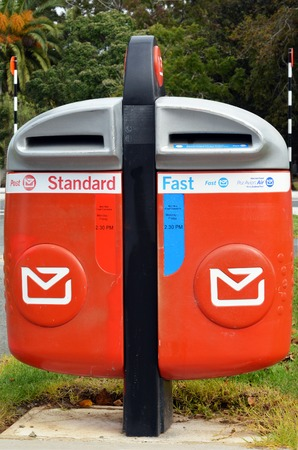 public address: Modern NZ Post Office mailing box outdoor. Stock Photo